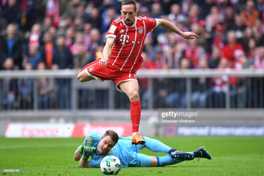 Franck Ribery of Bayern Muenchen (top) about to score a goal to make it 1:0 during the Bundesliga match between FC Bayern Muenchen and Hamburger SV at Allianz Arena on March 10, 2018 in Munich, Germany.