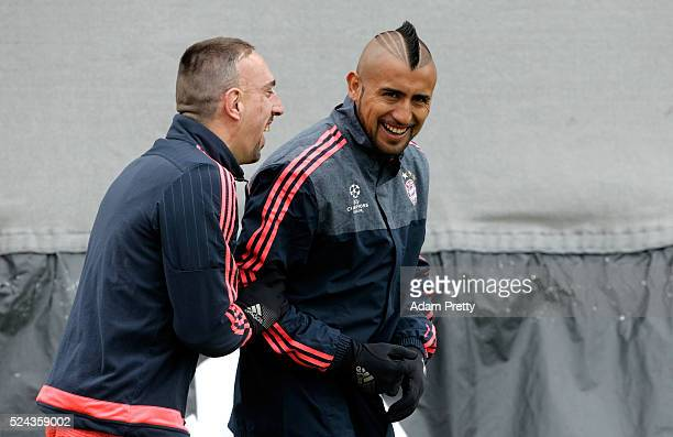 Franck Ribery of Bayern Muenchen and Arturo Vidal of Bayern Muenchen share a joke during a training session ahead of the UEFA Champions League Semi...