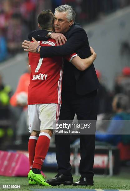 Franck Ribery of Bayern Muenchen and Carlo Ancelotti Manager of Bayern Muenchen embrace after he is subbed during the Bundesliga match between Bayern...