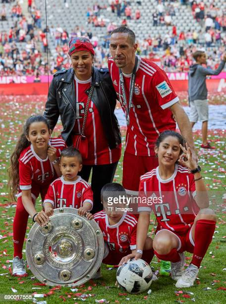 Franck Ribery of Bayern Muenchen and Familie poses with the Championship trophy in celebration of the 67th German Championship title following during...
