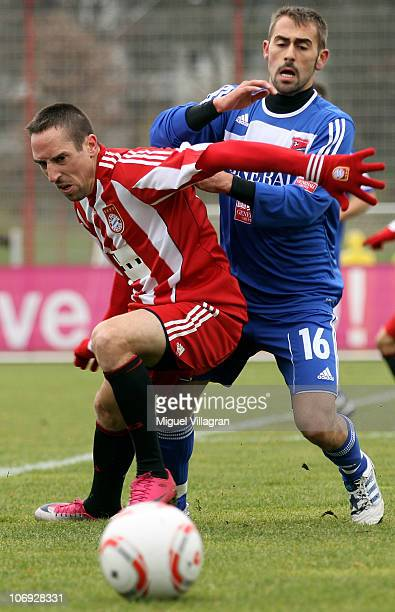 Franck Ribery of Bayern Muenchen and Orkan Balkan of Unterhaching fight for the ball during the friendly match between FC Bayern Muenchen and SpVgg...