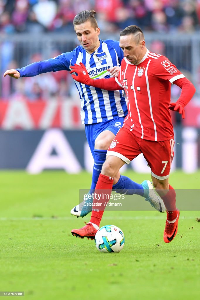 Franck Ribery of Bayern Muenchen and Peter Pekarik of Berlin compete for the ball during the Bundesliga match between FC Bayern Muenchen and Hertha BSC at Allianz Arena on February 24, 2018 in Munich, Germany.