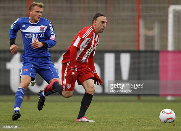 Franck Ribery of Bayern Muenchen and Thorsten Schulz of Unterhaching fight for the ball during the friendly match between FC Bayern Muenchen and...