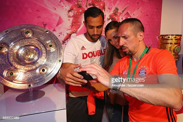 Franck Ribery of Bayern Muenchen attends with his team mate Medhi Benatia and his wife Cecile Benatia the FC Bayern Muenchen champions party at...