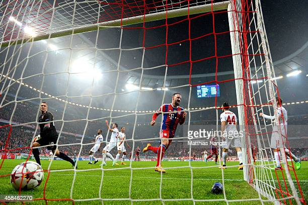 Franck Ribery of Bayern Muenchen celebrates as he scores their first goal past goalkeeper Lukasz Skorupski of AS Roma to during the UEFA Champions...