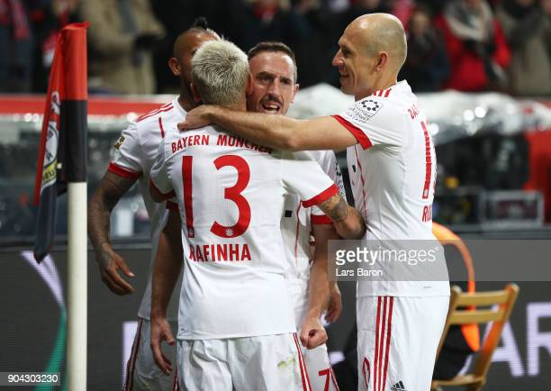 Franck Ribery of Bayern Muenchen celebrates as he scores their second goal with Rafinha and Arjen Robben during the Bundesliga match between Bayer 04...