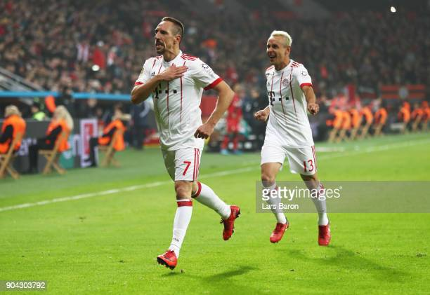 Franck Ribery of Bayern Muenchen celebrates as he scores their second goal with Rafinha during the Bundesliga match between Bayer 04 Leverkusen and...