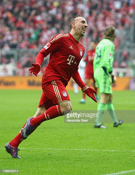 Franck Ribery of Bayern Muenchen celebrates his first goal against goalkeeper Timo Hildebrand of Schalke during the Bundesliga match between FC...