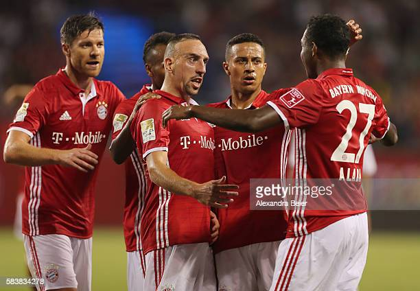 Franck Ribery of Bayern Muenchen celebrates his first goal together with teammates Xabi Alonso Julian Green Rafinha and David Alaba and Holger...