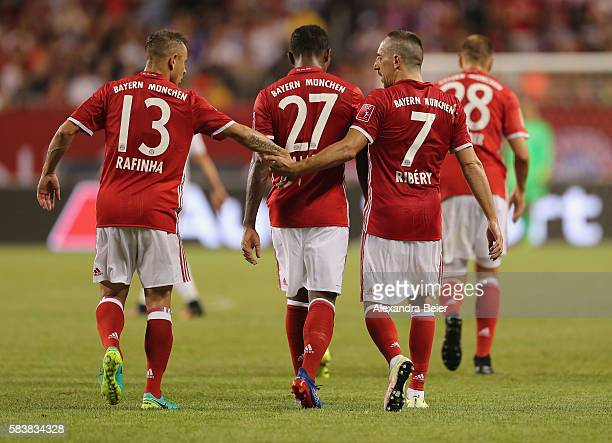 Franck Ribery of Bayern Muenchen celebrates his first goal together with teammates Rafinha David Alaba and Holger Badstuber during the International...