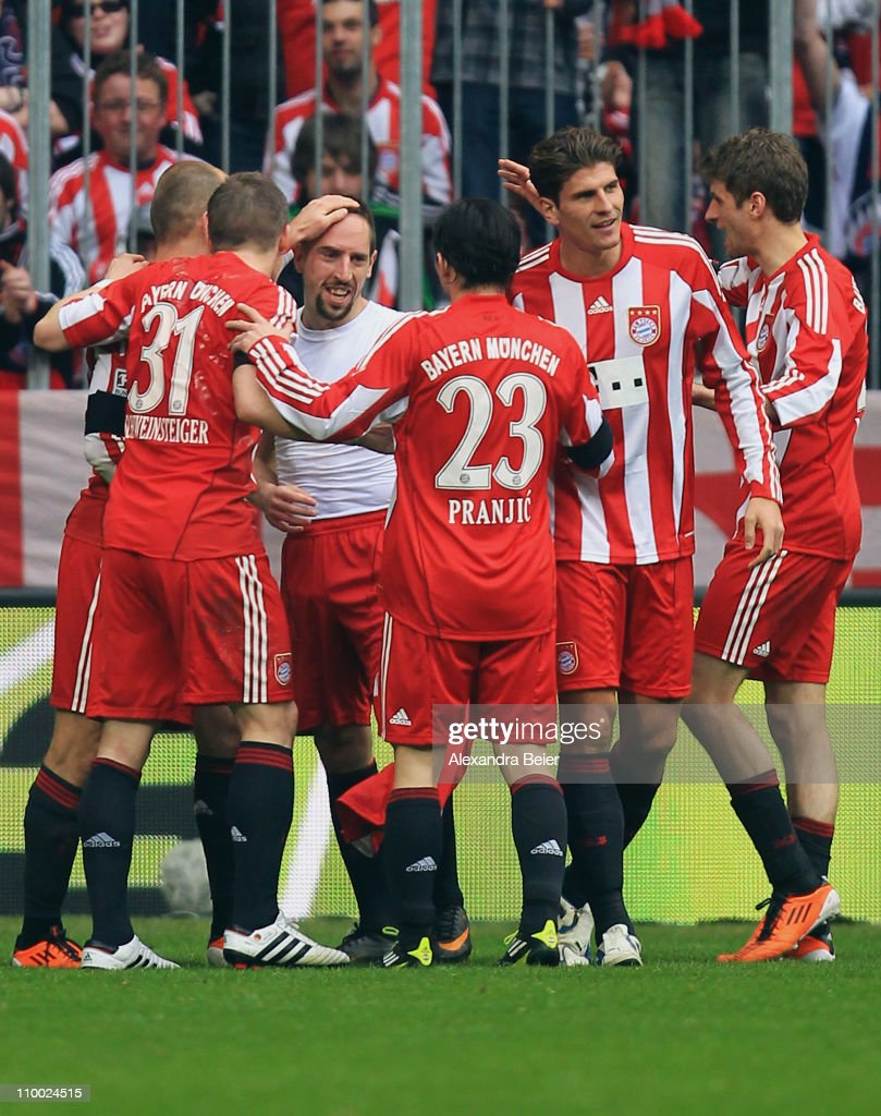 Franck Ribery (3rd L) of Bayern Muenchen celebrates his first goal with teammates during the Bundesliga match between 1. FC Muenchen and Hamburger SV at Allianz Arena on March 12, 2011 in Munich, Germany.