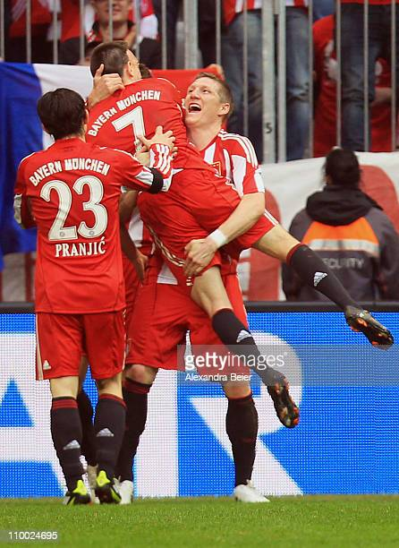 Franck Ribery of Bayern Muenchen celebrates his second goal with his teammates Danijel Pranjic and Bastian Schweinsteiger during the Bundesliga match...