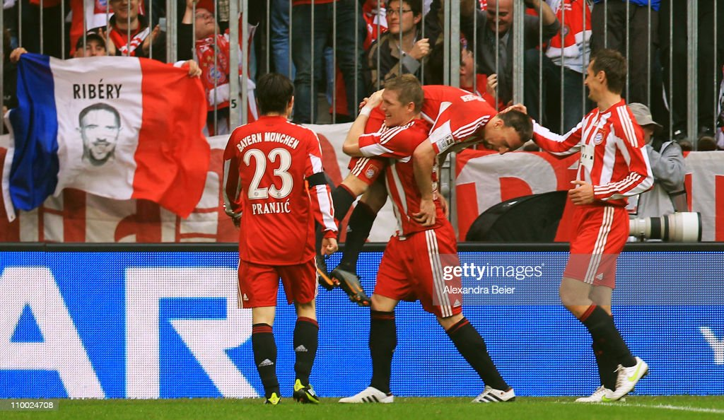 Franck Ribery (2nd R) of Bayern Muenchen celebrates his second goal with his teammates Danijel Pranjic, Bastian Schweinsteiger and Miroslav Klose (L-R)during the Bundesliga match between 1. FC Muenchen and Hamburger SV at Allianz Arena on March 12, 2011 in Munich, Germany.