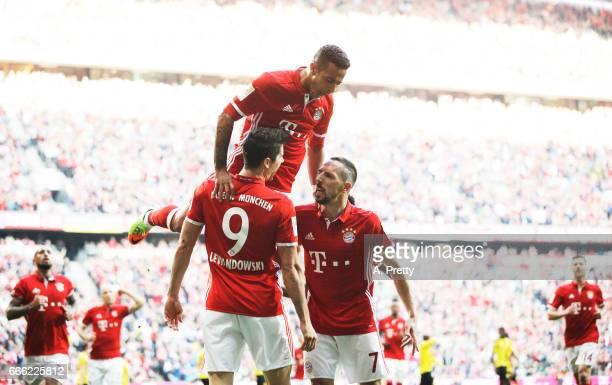 Franck Ribery of Bayern Muenchen celebrates scoring the opening goal with Robert Lewandowski and Thiago during the Bundesliga match between Bayern...
