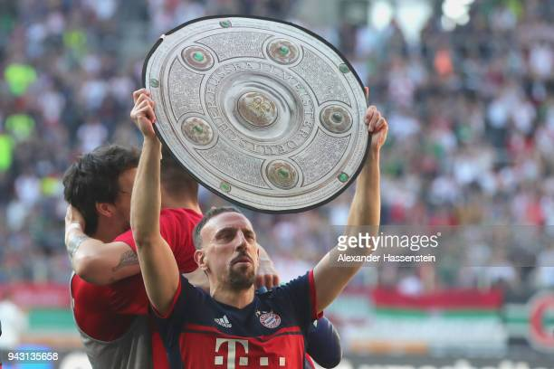 Franck Ribery of Bayern Muenchen celebrates winning the 6th championship back to back after the Bundesliga match between FC Augsburg and FC Bayern...