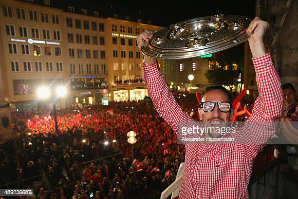 Franck Ribery of Bayern Muenchen celebrates winning the German championship title on the town hall balcony at Marienplatz on May 10 2014 in Munich...