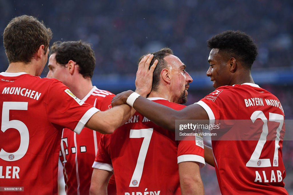 Franck Ribery of Bayern Muenchen celebrates with David Alaba of Bayern Muenchen (r) and other players, after he scored a goal to make it 5:0 during the Bundesliga match between FC Bayern Muenchen and Hamburger SV at Allianz Arena on March 10, 2018 in Munich, Germany.