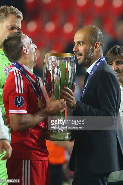 Franck Ribery of Bayern Muenchen celebrates with his head coach Pep Guardiola after winning the UEFA Super Cup between FC Bayern Muenchen and Chelsea...