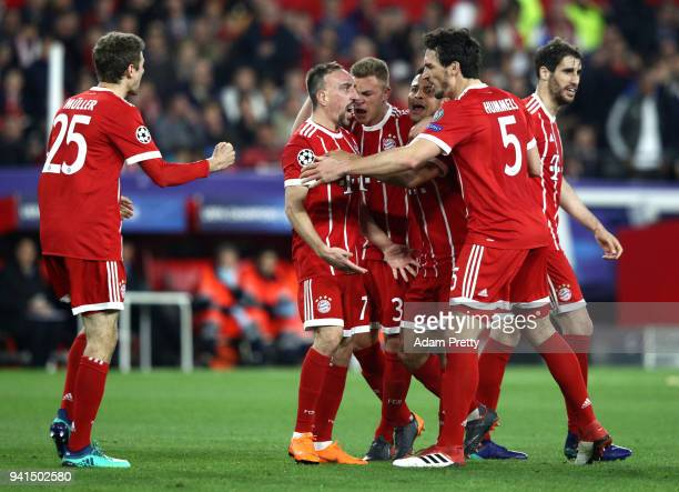 Franck Ribery of Bayern Muenchen celebrates with his team mates after scoring his sides first goal after his shot was deflected in by Jesus Navas of...