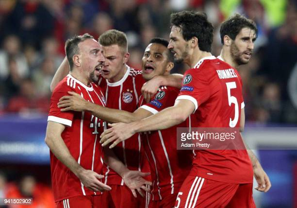 Franck Ribery of Bayern Muenchen celebrates with Mats Hummels of Bayern Muenchen after scoring his sides first goal after his shot was deflected in...