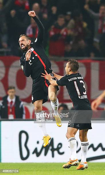 Franck Ribery of Bayern Muenchen celebrates with Rafinha after scoring the third goal during the DFB Cup match between Hamburger SV and FC Bayern...