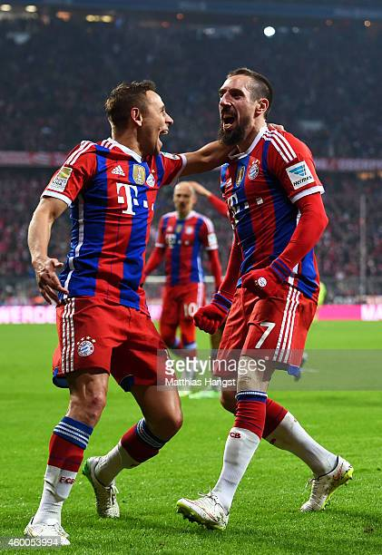Franck Ribery of Bayern Muenchen celebrates with teammate Rafinha of Bayern Muenchen after scoring the opening goal during the Bundesliga match...