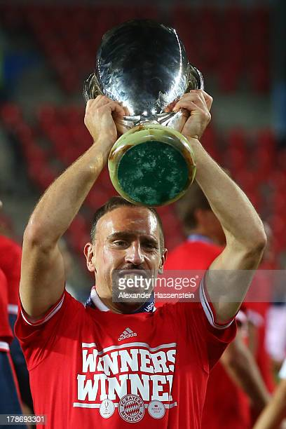 Franck Ribery of Bayern Muenchen celebrates with the Super Cup trophy after winning the UEFA Super Cup between FC Bayern Muenchen and Chelsea FC at...