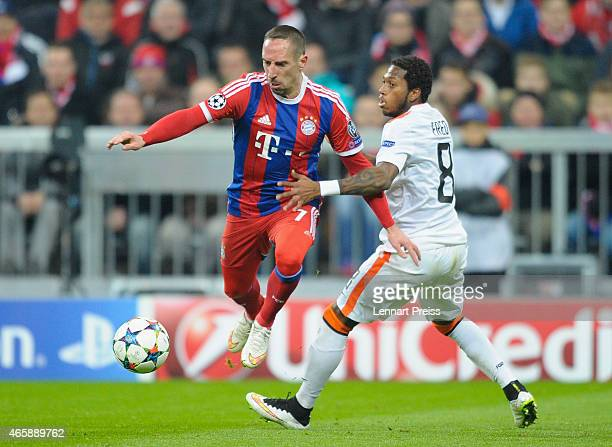 Franck Ribery of Bayern Muenchen challenges Fred of Shakhtar Donetsk during the UEFA Champions League Round of 16 second leg match between FC Bayern...
