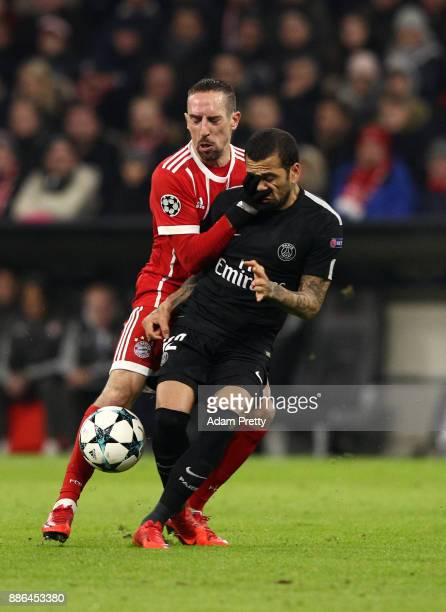 Franck Ribery of Bayern Muenchen challenges with Dani Alves of PSG during the UEFA Champions League group B match between Bayern Muenchen and Paris...