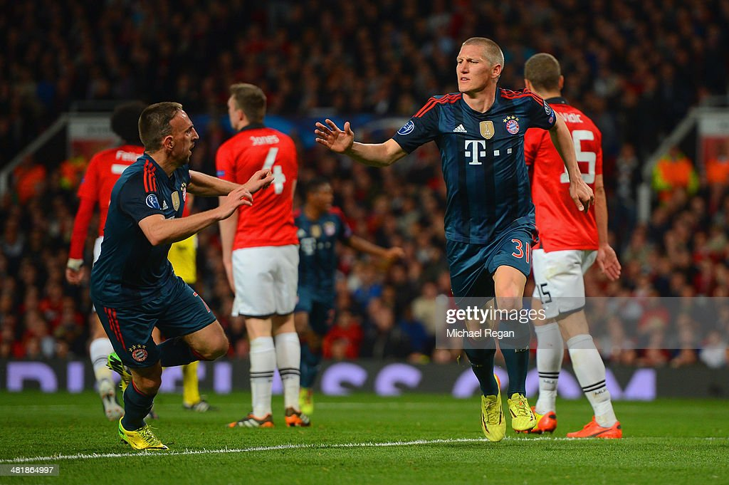 Franck Ribery of Bayern Muenchen congratulates Bastian Schweinsteiger of Bayern Muenchen on scoring their first goal during the UEFA Champions League Quarter Final first leg match between Manchester United and FC Bayern Muenchen at Old Trafford on April 1, 2014 in Manchester, England.