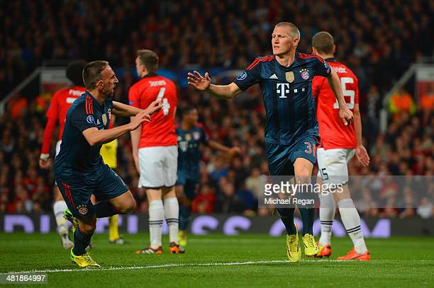 Franck Ribery of Bayern Muenchen congratulates Bastian Schweinsteiger of Bayern Muenchen on scoring their first goal during the UEFA Champions League...