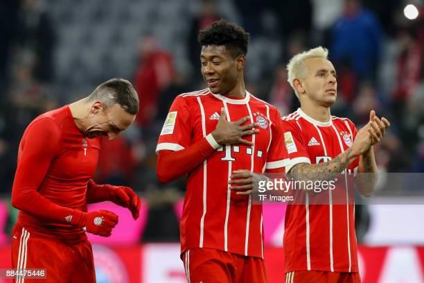 Franck Ribery of Bayern Muenchen David Alaba of Bayern Muenchen and Rafinha of Bayern Muenchen celebrate after winning the Bundesliga match between...