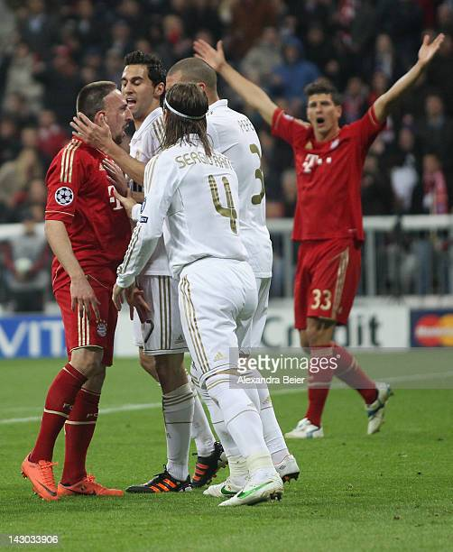Franck Ribery of Bayern Muenchen discusses with Alvaro Arbeloa Sergio Ramos and Pepe of Real Madrid during the UEFA Champoins League Semi Final first...