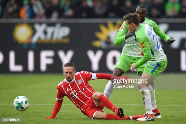 Franck Ribery of Bayern Muenchen fights for the ball with Joshua Guilavogui of Wolfsburg and Divock Origi of Wolfsburg during the Bundesliga match...
