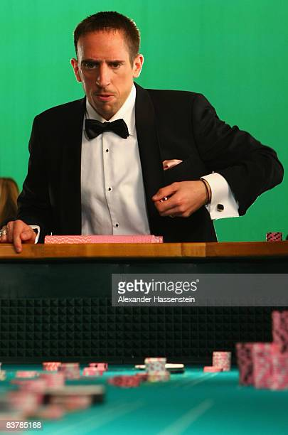 ACCESS Franck Ribery of Bayern Muenchen gambles craps during the Nike Mercurial Vapor Rosa shoot on November 7 2008 in Munich Germany