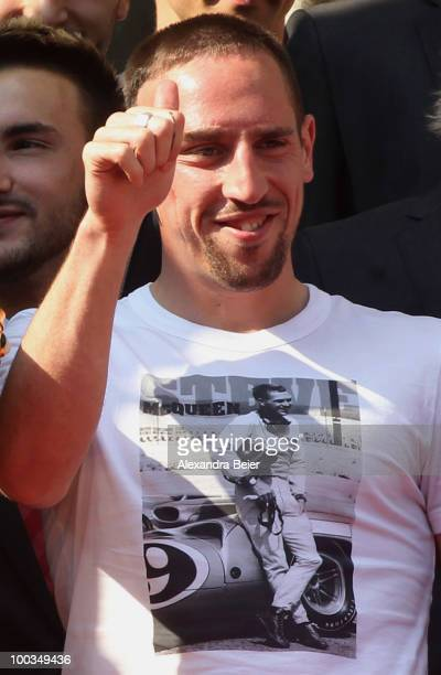 Franck Ribery of Bayern Muenchen gives a thumb up after he confirmed to extend his contract until 2015 during the celebration of the two titles at...