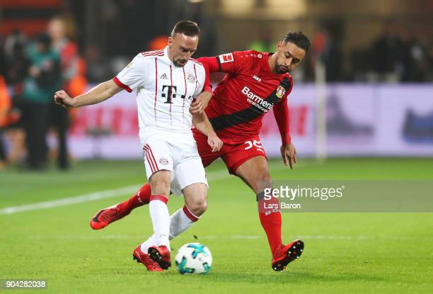 Franck Ribery of Bayern Muenchen holds off Karim Bellarabi of Bayer Leverkusen during the Bundesliga match between Bayer 04 Leverkusen and FC Bayern...