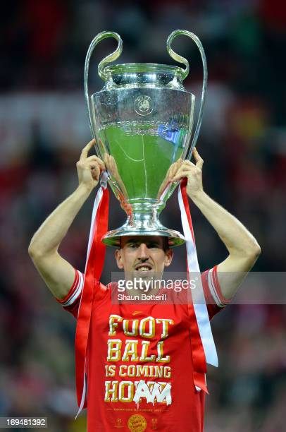 Franck Ribery of Bayern Muenchen holds the trophy after winning the UEFA Champions League final match against Borussia Dortmund at Wembley Stadium on...