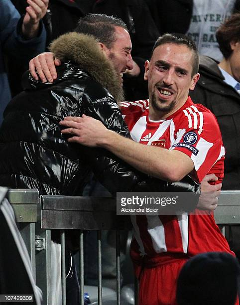 Franck Ribery of Bayern Muenchen hugs an unidentified man after he scored his second goal during the Champions League Group E match between FC Bayern...