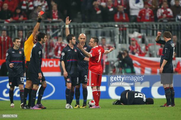 Franck Ribery of Bayern Muenchen is booked red card by referee Roberto Rosetti during the UEFA Champions League semi final first leg match between FC...