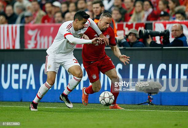 Franck Ribery of Bayern Muenchen is challenged by Andre Almeida of Benfica during the UEFA Champions League quarter final first leg match between FC...