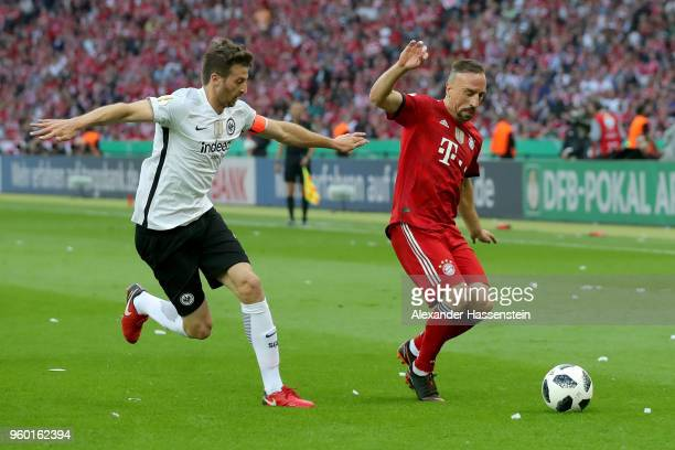 Franck Ribery of Bayern Muenchen is challenged by David Abraham of Eintracht Frankfurt during the DFB Cup final between Bayern Muenchen and Eintracht...