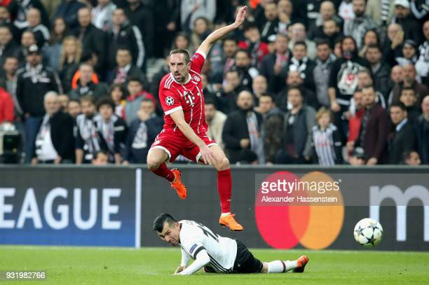 Franck Ribery of Bayern Muenchen is challenged by Gary Medel of Besiktas during the UEFA Champions League Round of 16 Second Leg match Besiktas and...