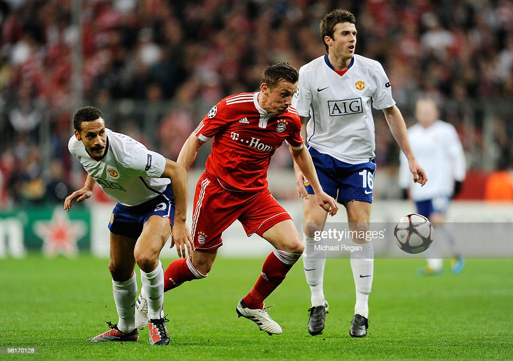 Franck Ribery of Bayern Muenchen is challenged by Rio Ferdinand and Michael Carrick of Manchester United during the UEFA Champions League quarter final first leg match between Bayern Muenchen and Manchester United at the Allianz Arena on March 30, 2010 in Munich, Germany.