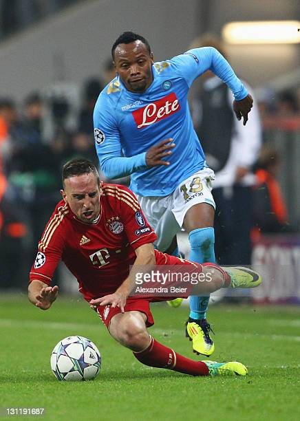 Franck Ribery of Bayern Muenchen is fouled by Juan Zuniga of Napoli during the UEFA Champions League Group A match between FC Bayern Muenchen and SSC...