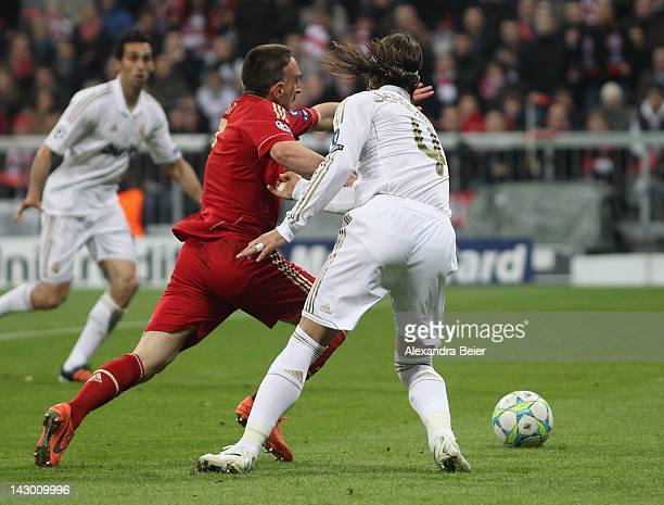 Franck Ribery of Bayern Muenchen is fouled by Sergio Ramos of Real Madrid in the 16th minute during the UEFA Champoins League Semi Final first leg...