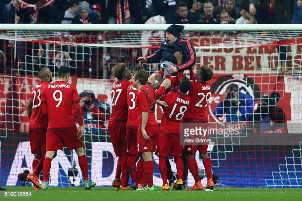 Franck Ribery of Bayern Muenchen is lifted by his team mates to celebrate their 42 win in the UEFA Champions League round of 16 second Leg match...