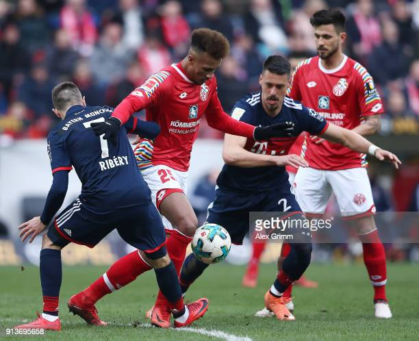 Franck Ribery of Bayern Muenchen JeanPhilippe Gbamin of Mainz and Sandro Wagner of Muenchen fight for the ball during the Bundesliga match between 1...