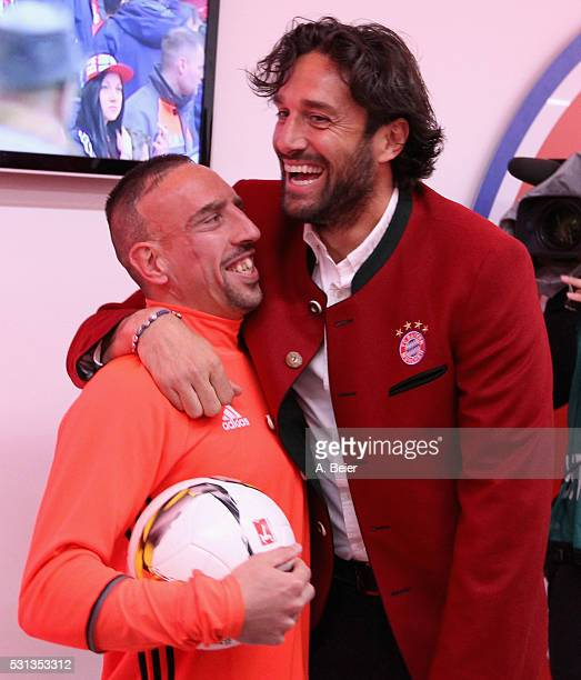 Franck Ribery of Bayern Muenchen jokes with former Bayern Muenchen player Luca Toni before the Bundesliga match between FC Bayern Muenchen and...