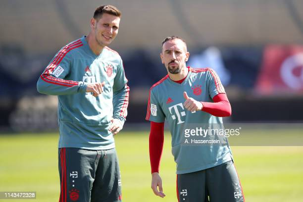 Franck Ribery of Bayern Muenchen jokes with his team mate Niklas Suele during a FC Bayern Muenchen training session at Saebener Strasse training...